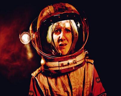 A woman in an astronauts helmet