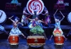 The Japanese Yamato drummers exuberantly raise their drumsticks in preparation