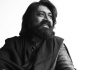 Musician Talvin Singh smiles and looks off to the right. Black and white.