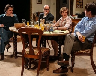 A group of actors talking around a kitchen table in the play Limehouse, one of the tutor's well-known plays