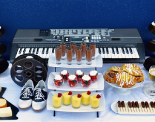 A la la land themed buffet with a keyboard, Seb's labelled cupcakes and other musical items