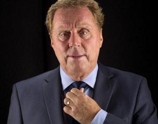 Harry Redknapp in a suit, adjusting his tie