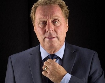 Harry Redknapp in a suit, adjusting his tie