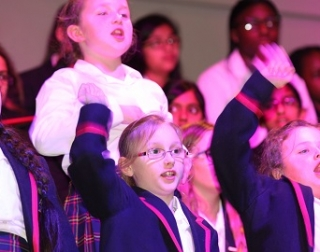 A group of school children photographed in purple lighting