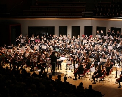 An orchestra made up of seated young musicians
