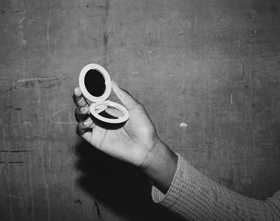 Black and white. A hand holding a compact mirror.
