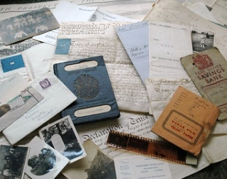 Memorabilia consisting of an old blue passport, old letters, photos and documents