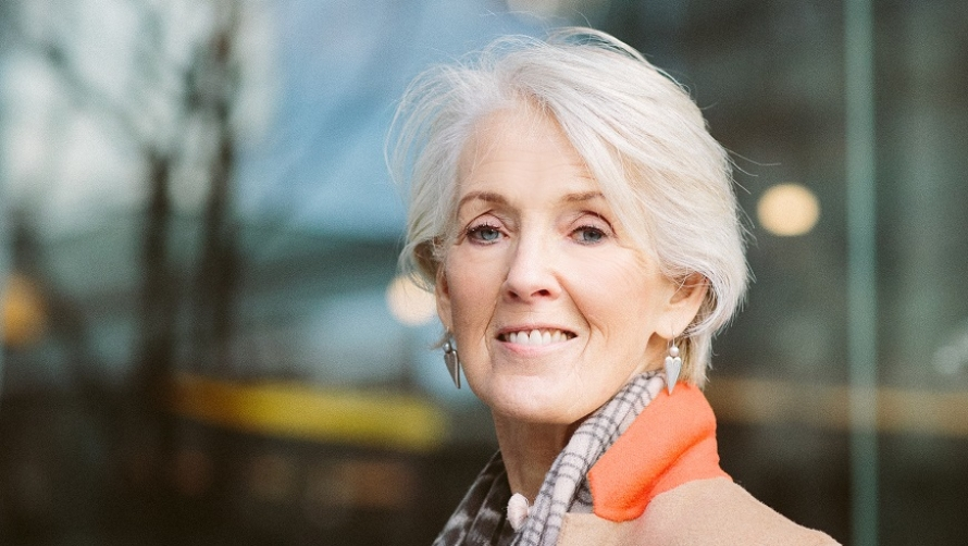 Author Joanna Trollope smiles at the camera.