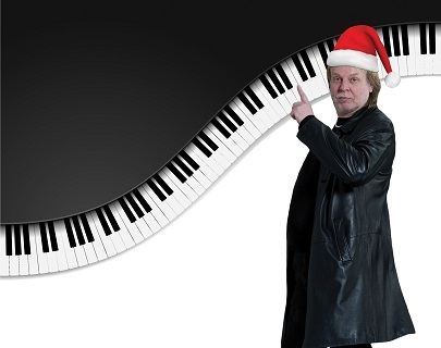 A man wearing a black coat and a Santa hat points at a illustration of piano keys