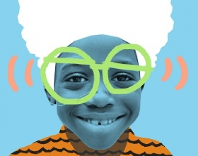 Boy smiles at camera with painted on glasses