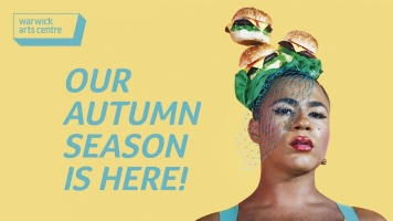 A person stands against a yellow background, wearing a hat and veil made of burgers as they look at the camera. Text reads: Our Autumn Season Is Here! and the Warwick Arts Centre logo is in the top left corner.
