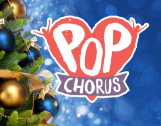 "I pink heart with a purple banner reads ""Pop Chorus"". It is set against a blue background and next to a Christmas tree."
