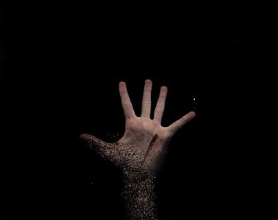 A bloody hand outstretched against a black background.