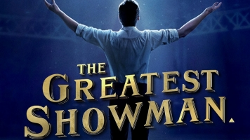 The Greatest Showman movie poster, depicting Hugh Jackman in character with his arms spread out