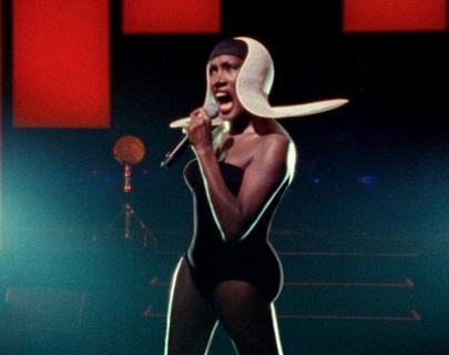 Garce Jones singing onstage in an elaborate outfit