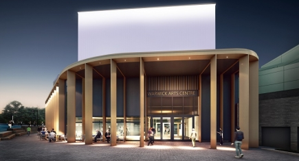 "An artist's impression of Warwick Arts Centre during the evening. It shows the outside of a building with beams supporting the roof, with a sign above the glass doors reading ""Warwick Arts Centre"" and people sitting on cafe chairs and tables outside. The building is illuminated."