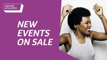"A purple banner with words saying ""New Events on Sale"". There is an image of a woman smiling with her eyes closed and her arms in the air."