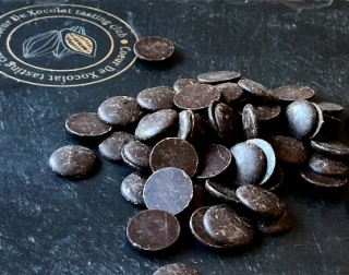 Chocolate buttons placed on a slate