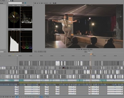 An image of a man in braces on a stage, being edited in video editing software.