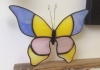 A stained glass butterfly decoration.