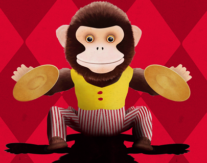 A cartoon monkey in a yellow waistcoat and stripy trousers, sat down and playing the cymbals.