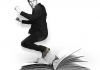 A black and white image of comedian Rhod Gilbert jumping out of a large, open book