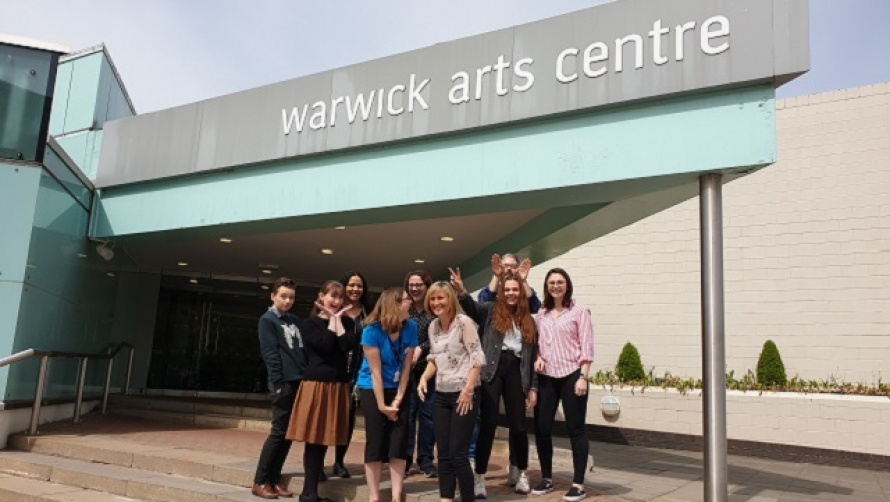 Arts Centre staff standing at the entrance to Warwick Arts Centre