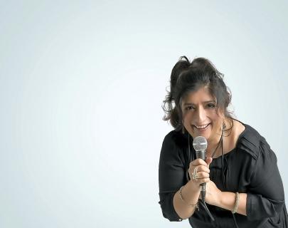 Sajeela Kershi smiling and holding a microphone