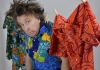 Comedian Milton Jones hung up on a washing line with pegs