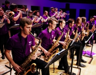 Big Band - group of saxophonists playing the saxophone