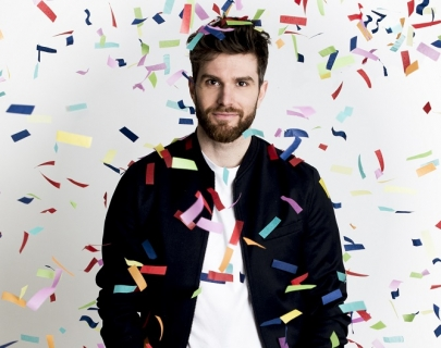 Joel Dommett covered in confetti