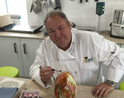 David Greenwood-Haigh poses with one of his chocolate egg creations