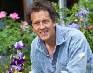 Gardening writer Monty Don surrounded by flowers