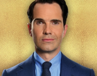 Jimmy Carr on a gold background