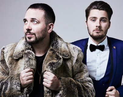Comedy duo - Abandoman - one wearing a fur coat and one in a blue dinner jacket