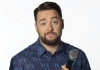 Comedian Jason Manford holding a microphone