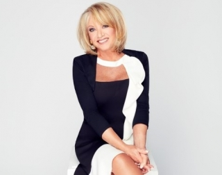 Performer Elaine Paige on a neutral background