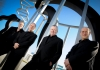 Coull Quartet musicians in black suits standing outside