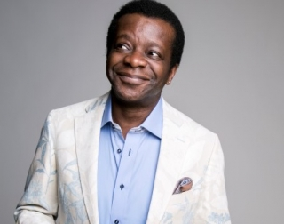 Comedian Stephen K Amos on a neutral background