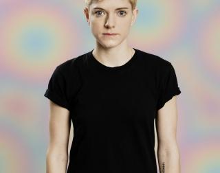Mae Martin on a white background