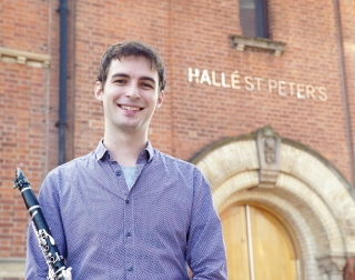 Clarinet player, Sergio Castello Lopez standing outside The Halle building
