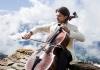 Celist Gautier Capuçon playing the cello outdoors