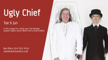 Victoria Melody as funeral director, Mike Melody in a white coffin