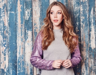 Comedian Katherine Ryan on a colourful background