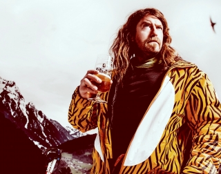 Comedian Craig Campbell dressed in a tiger stripped coat