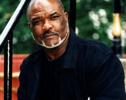 Sir Willard White sitting on stairs