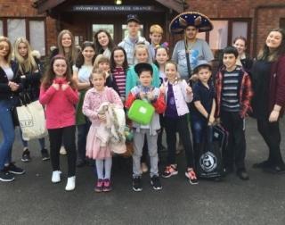 Children standing outside Kenilworth Grange building