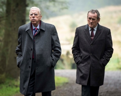 Actors Timothy Spall and Colm Meaney walking in the woods