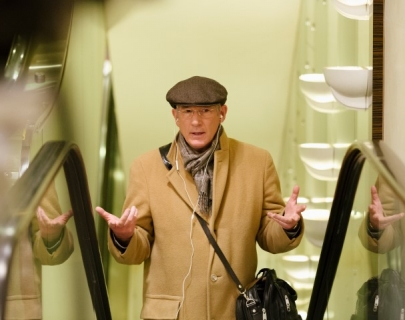 Actor Richard Gere on an escalator