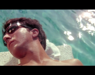 Actor Dustin Hoffman wearing glasses in a swimming pool